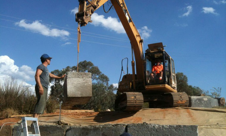 A one-tonne waste concrete block gets craned into place. Photo courtesy Archier.