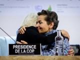 UNFCCC executive secretary Christiana Figueres embraces a colleague after the Paris Agreement is struck.