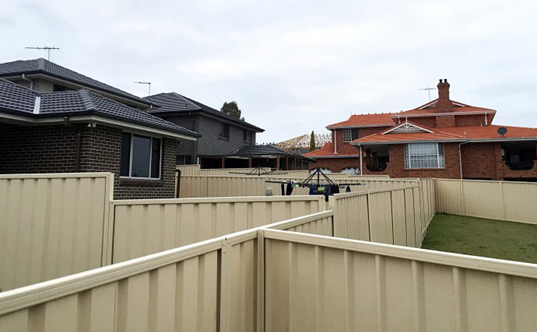 Fenced-in: a photo taken in Casula, Sydney. Otherothers seek a more open vision of suburbia. Photo by Damien Power.