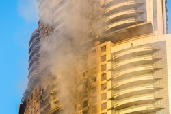 The aftermath of a fire that tore through flammable aluminium composite cladding on a 63-storey hotel in Dubai on New Years Eve 2015.