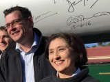 Victorian Premier Daniel Andrews and Energy, Environment and Climate Change Minister Lily D'Ambrosio after signing a wind turbine for the Ararat wind farm.