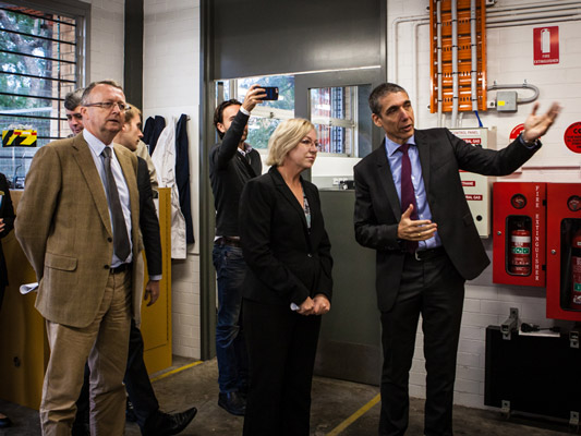 Faculty of Engineering, Architecture and Information Technology Dean Professor Simon Bigg, Minister for Agriculture and Fisheries Leanne Donaldson and Civil Engineering head Professor Jose Torero look through the facility.