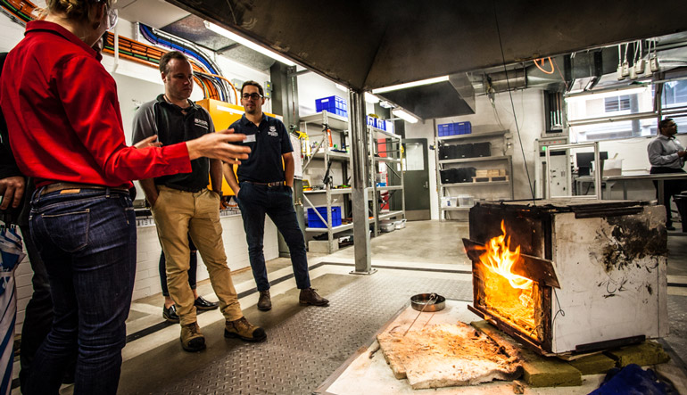 A demonstration showing the fire-safe properties of wood