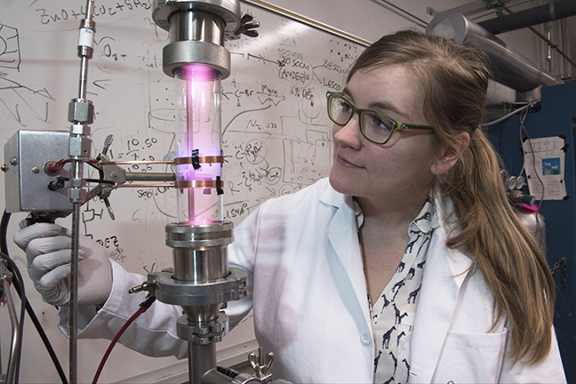 University of Minnesota researcher Samantha Ehrenberg uses a plasma reactor to create silicon nanoparticles that are the key ingredient in the solar concentrators. Photo credit: University of Minnesota