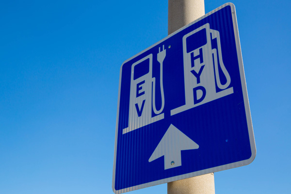 A sign for EV and HYD cars to charge and fuel.