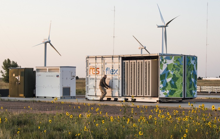 August 29, 2017 -  Sr. Project Leader, Jim Green, opens the doors on the Flex manufactured battery enclosure,1 MW, 1 MWh rating, using lithium ion batteries from LG, at the Battery Energy Storage System, owned and operated by NREL for grid integration research at the NWTC. (Photo by Dennis Schroeder / NREL)