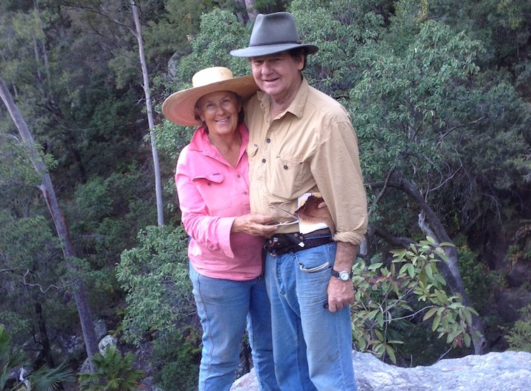 man and woman hugging in bushland
