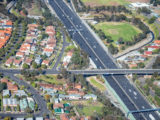 Aerial view of Melbourne main interstate road and overpass.