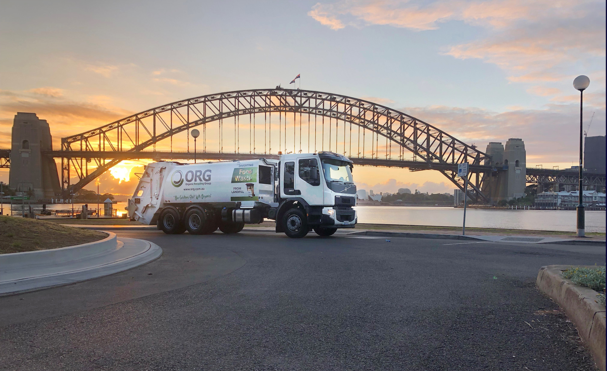 photo of an ORG recycling truck in front of the Sydney Harbour Bridge