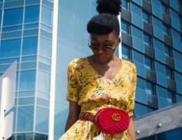 woman in yellow dress and Gucci bag