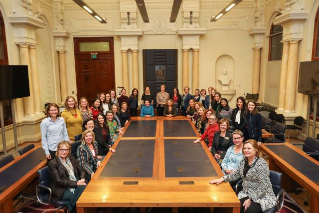 Women for climate sitting around table