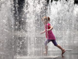 girl Playing in the Water Fountain