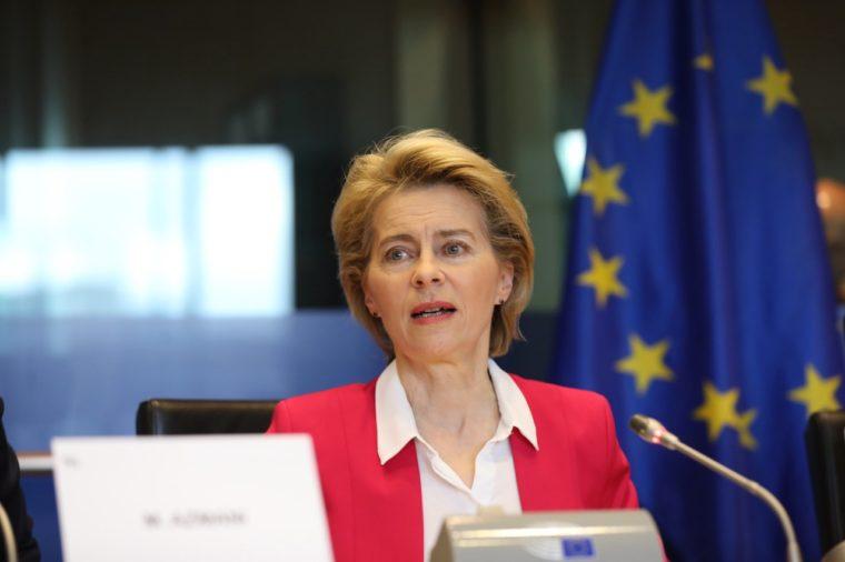 women speaking at event