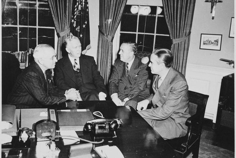 men sitting in whitehouse