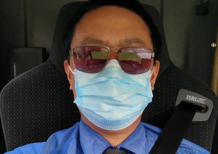 male bus driver wearing mask