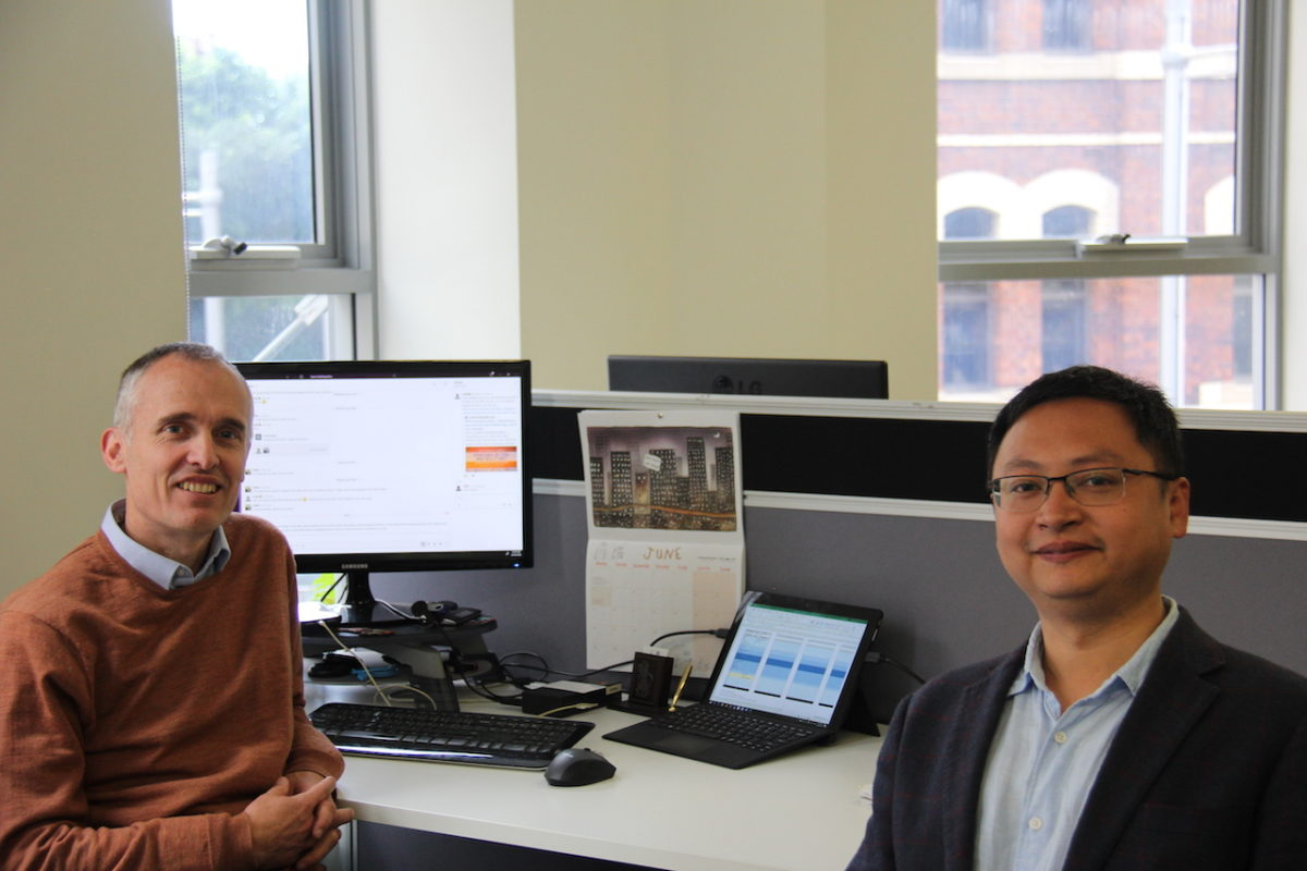two men in front of a compter