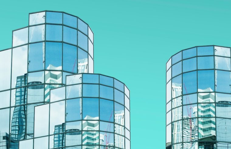 three buildings with blue background