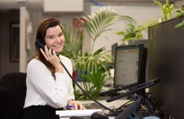 woman smiling while on phone