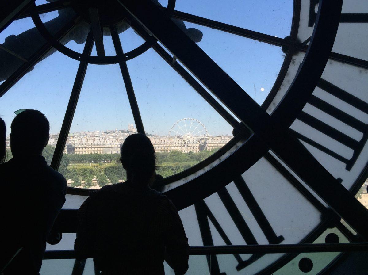 Tourists near the huge clocks in paris