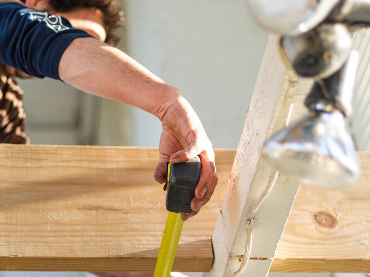 tradesman with measuring tape