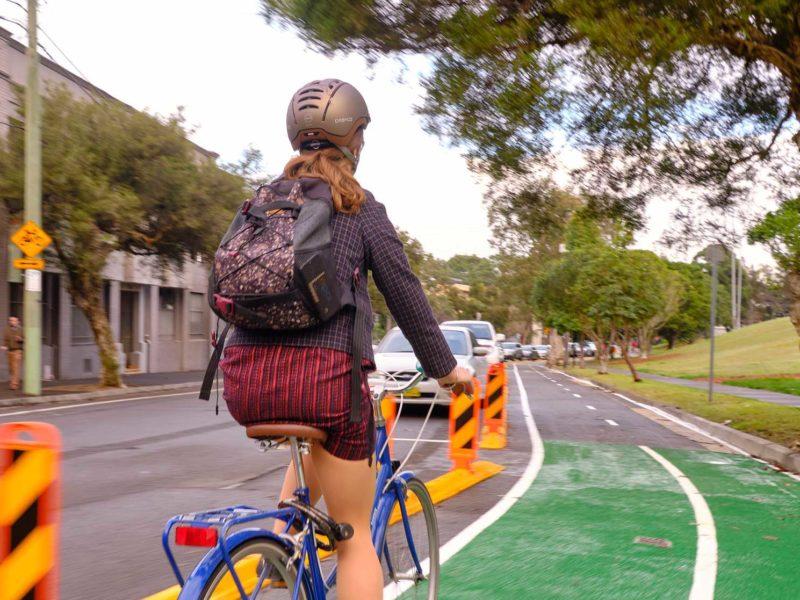 woman cycling on sydney roads